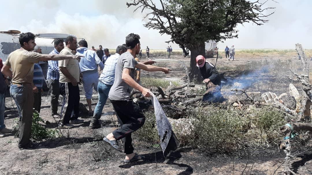 في الوقت نفسه... النيران تلتهم عدة حقول زراعية في كوباني