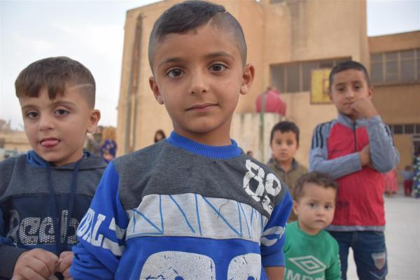 طفل نازح من العدوان التركي: أقول للدول العالمية تعالوا لمساعدتنا
