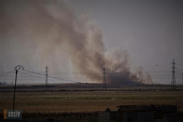 الاحتلال التركي يضرم النيران في حقول ريف تل تمر