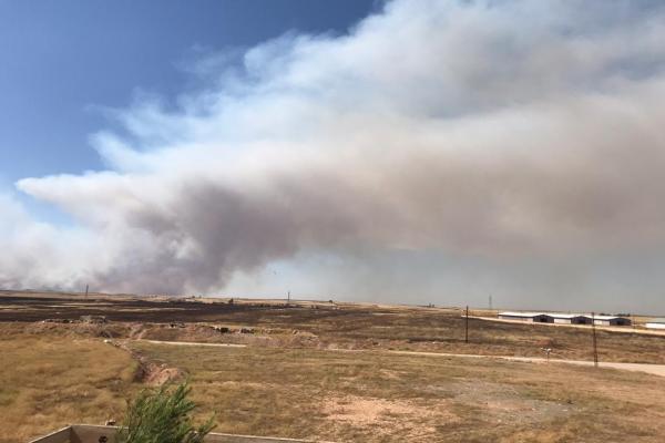 تركيا تحرق محاصيل الأهالي في ريف تل تمر