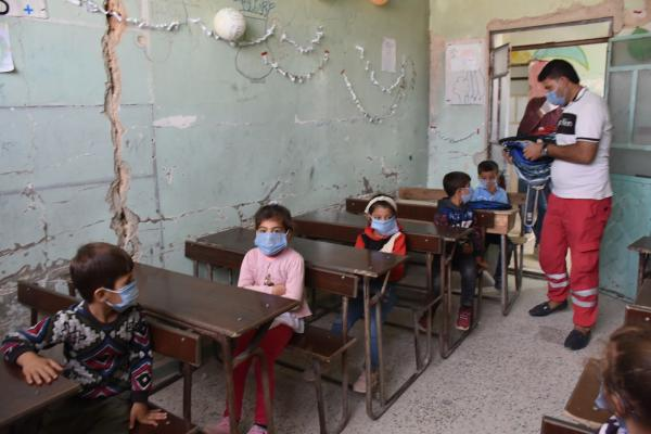 Kurdish Red Crescent provides school bags to students in besieged al-Shahba canton
